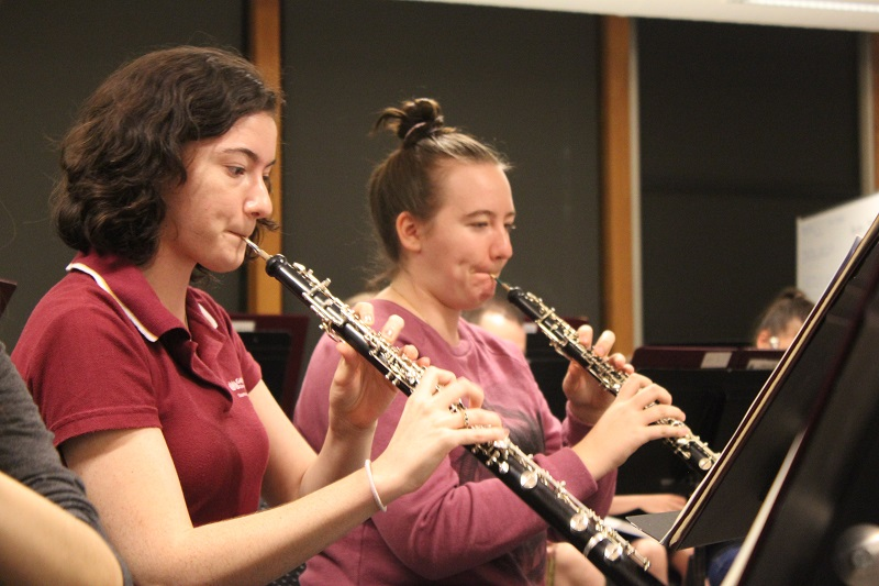 woodwind students rehearsing in an orchestral setting