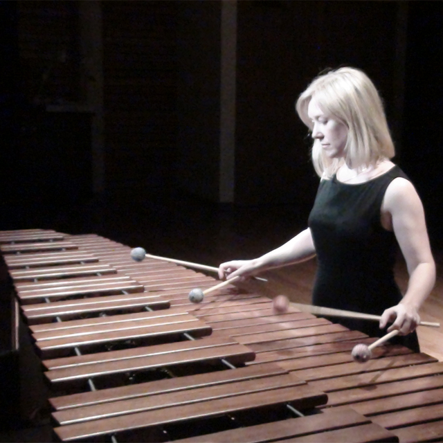 Female playing a xylophone